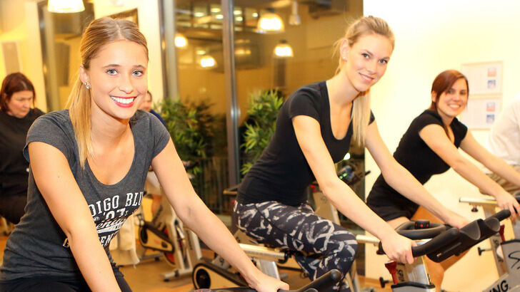 Female Athletes on spinning bikes