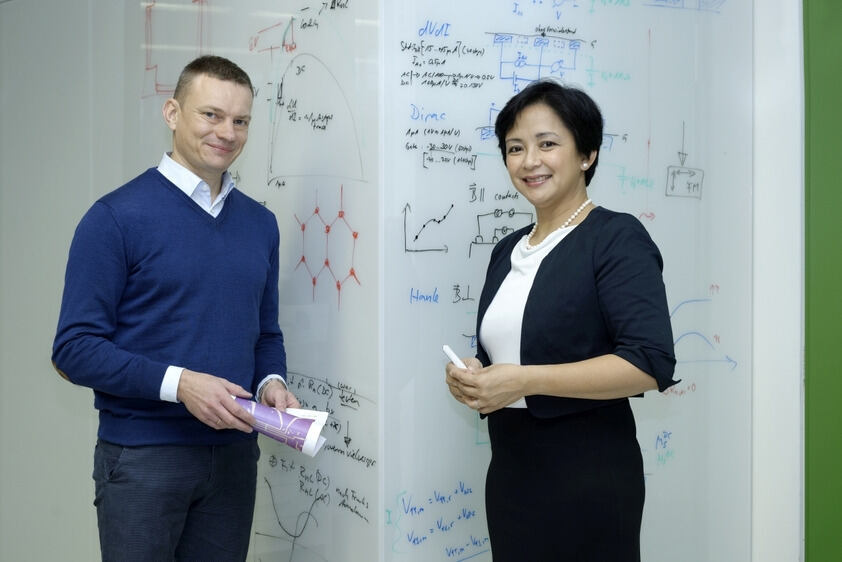 A man and a woman in front of a whiteboard